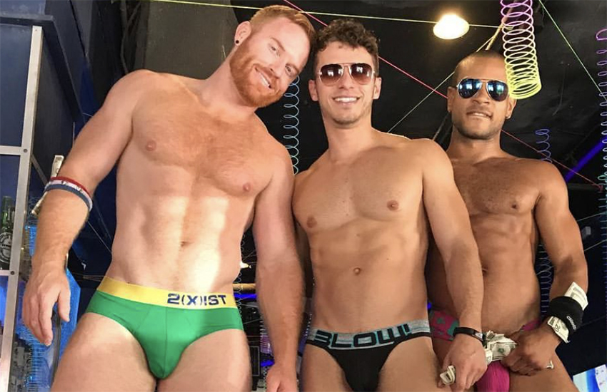 Model and go-go dancer Seth Fornea (left) and friends at Southern Decadence