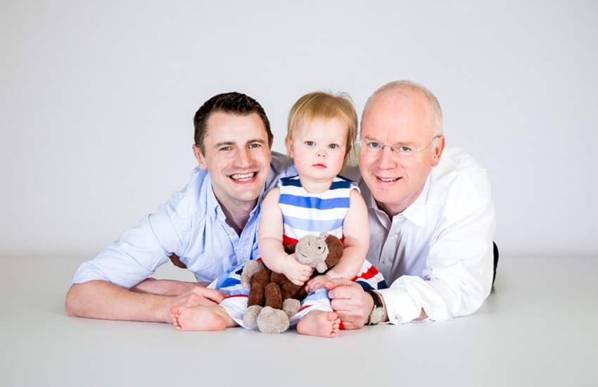 Malcolm Cuthbert of Equality Wealth with his husband and one of their children.