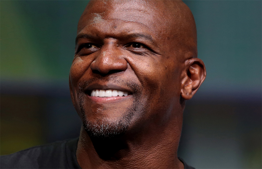 Terry Crews closeup shot he is looking up to his right and is smiling