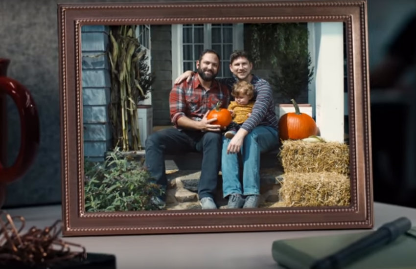 A still from HP's LGBTQ tech initiative, showing a photo frame of a gay family on a work desk