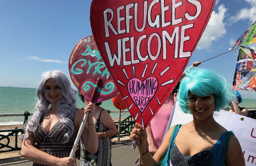 Activists at Brighton pride who support refugees coming to the UK