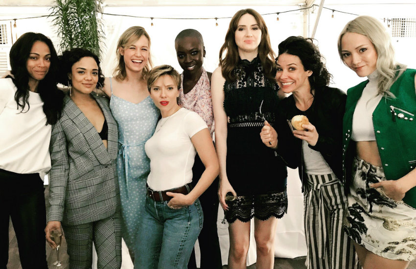 The women of Marvel pose for a photo, including Tessa Thompson in a suit.