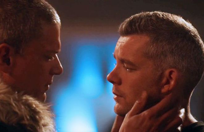Wentworth Miller and Russell Tovey share superhero kiss