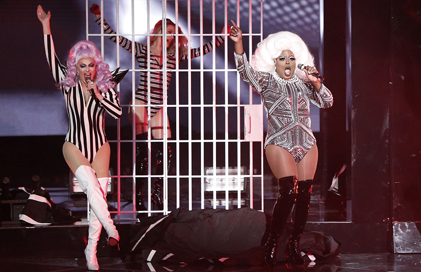 Chris performs in drag in The Voice finale