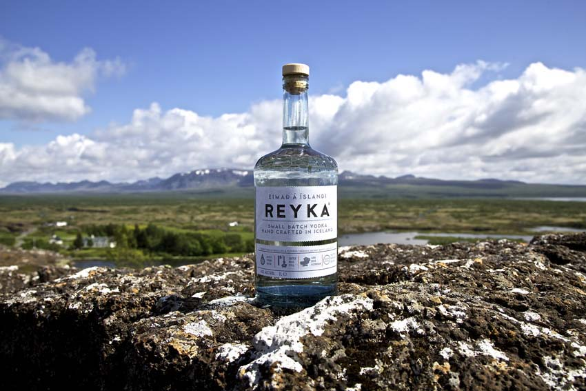 A bottle of Reyka against an Icelandic backdrop