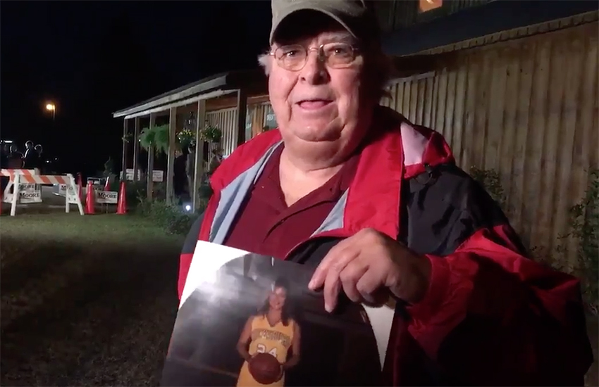 Nathan Mathis proests outside a Roy Moore rally in Midland City last night