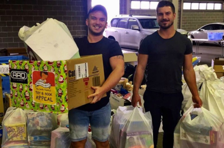 Jack Rae from ARQ Sydney (L) with friend collecting toys for the Smith Family's Christmas Appeal