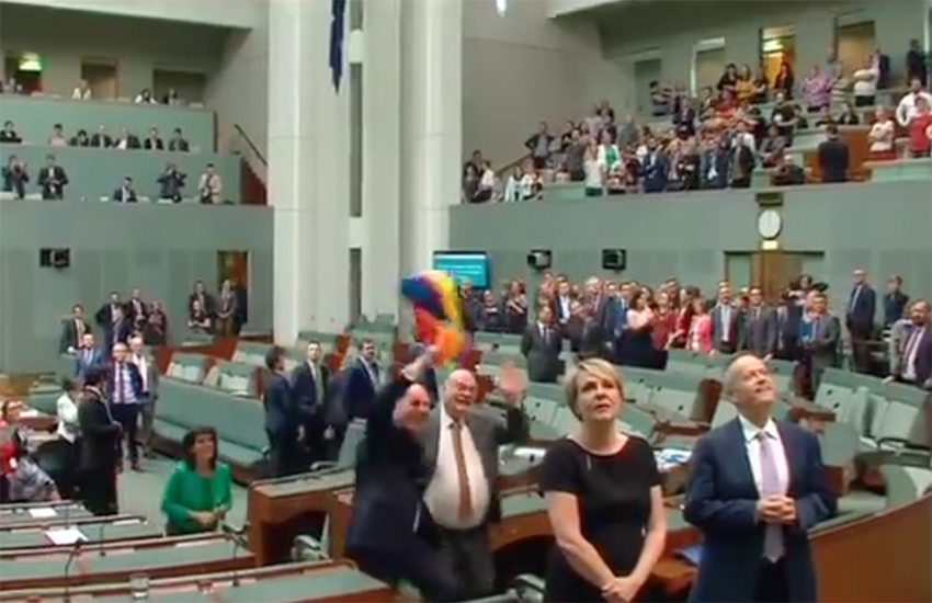 MPs join onlookers in song at the Auustralia Parliament today