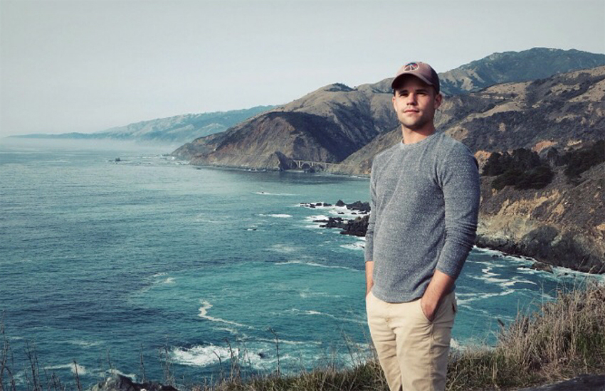 Charlie Carver poses by the coast at Big Sur