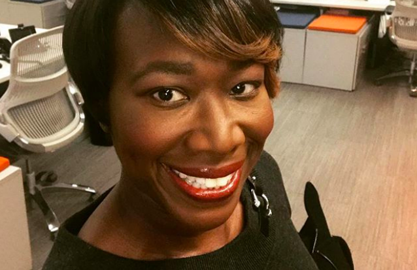 Joy Reid is an American TV host. This picture shows her in a newsroom.