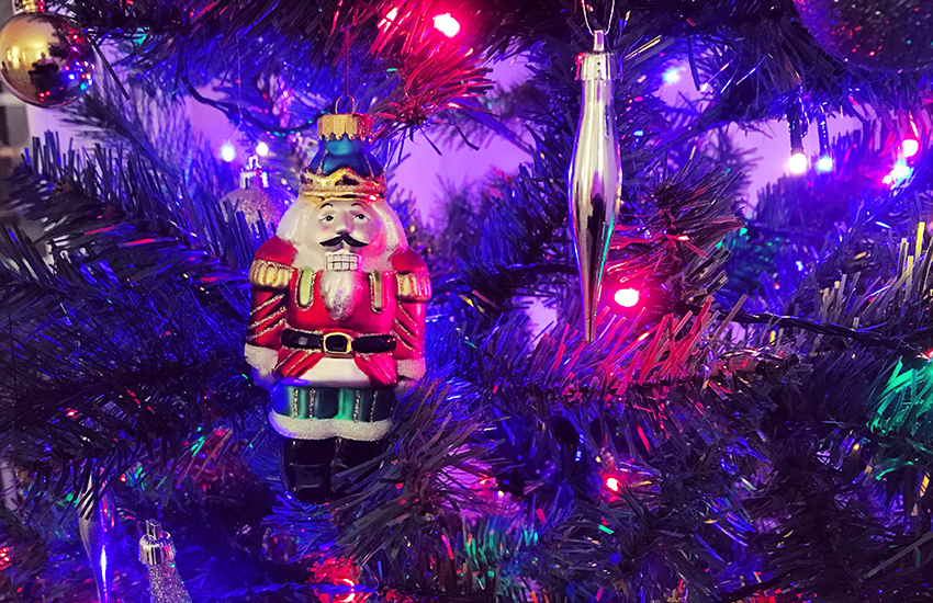 A lonely ornament of a soldier on a Christmas tree