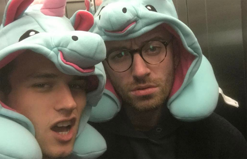 Brandon Flynn and Sam Smith in hats shaped like unicorns