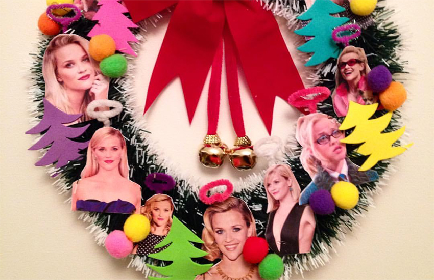 A Christmas wreath decorated with images of Reese Witherspoon