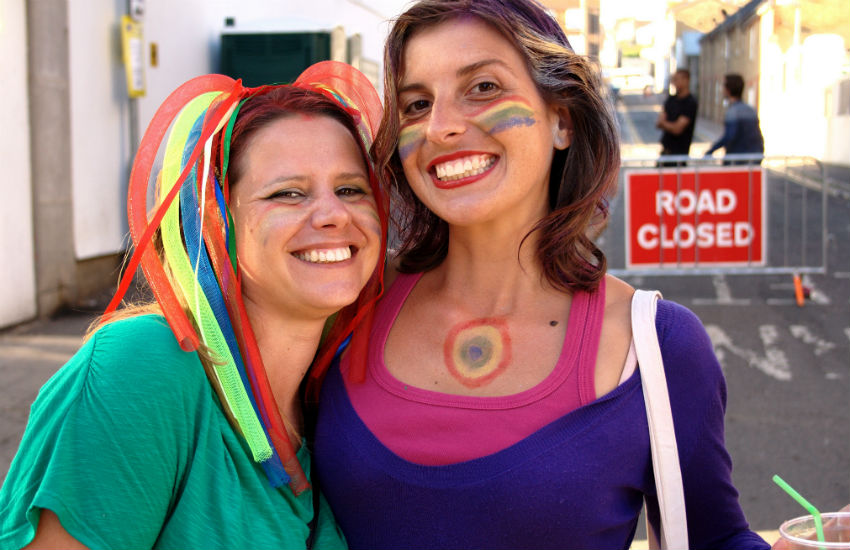 Two bisexual women at Brighton Pride party bisexual float