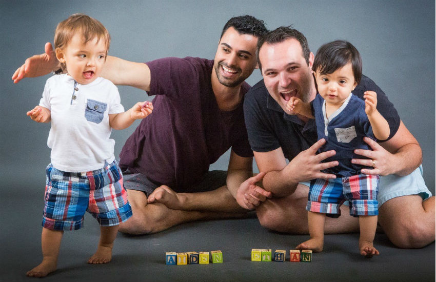 Gay dads Andrew and Elad with toddler twin sons Ethan and Aiden