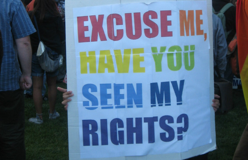 Person holding a protest sign in San Francisco