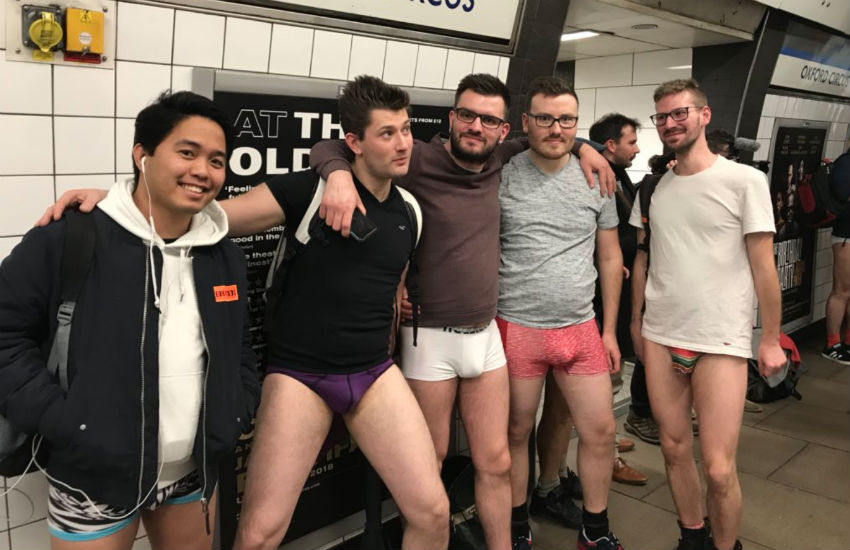 A group of young men participate in London's annual No Trousers Tube Ride