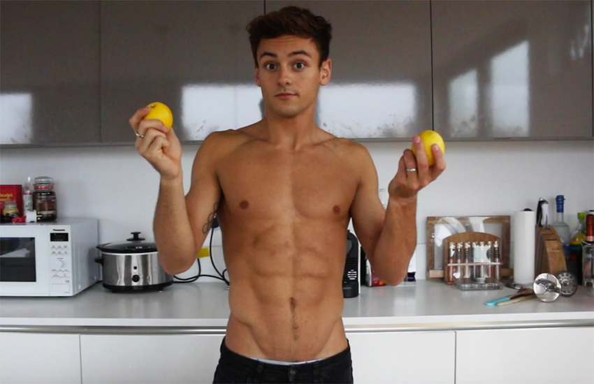 Tom Daley topless in his kitchen holding lemons