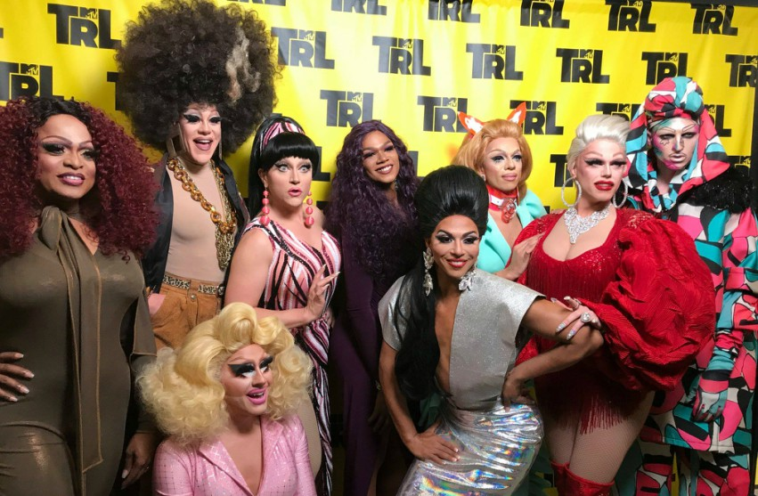The cast of RuPaul's Drag Race All Stars 3 posing for media photos on the red carpet