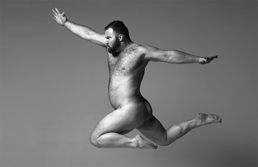 A larger man leaps in the air as part of the Arrested Movement project