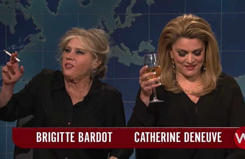 Screen shot of Kate McKinnon and Cecily Strong as French actresses Brigitte Bardot and Catherine Deneuve
