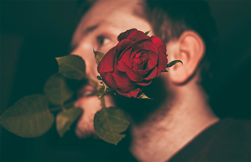 A man with a rose in his mouth - column on bad dates and dating