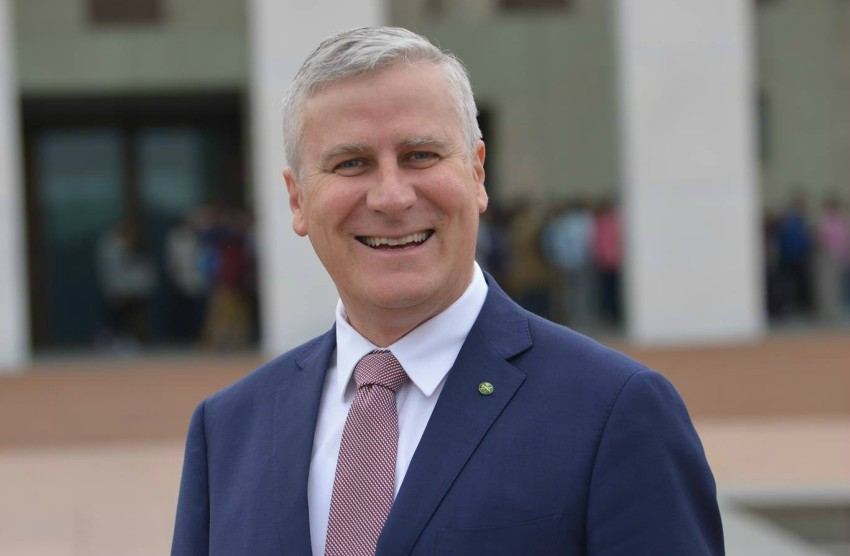 Close shot of Michael McCormack wearing a suit and smiling standing in front of Parliament House