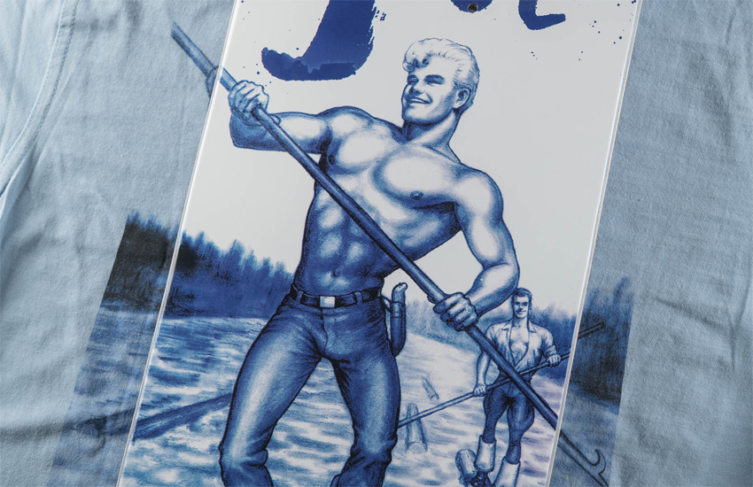 A close-up of one of the skateboards and T-shirts in the new Tom of Finland Happy Hours collection