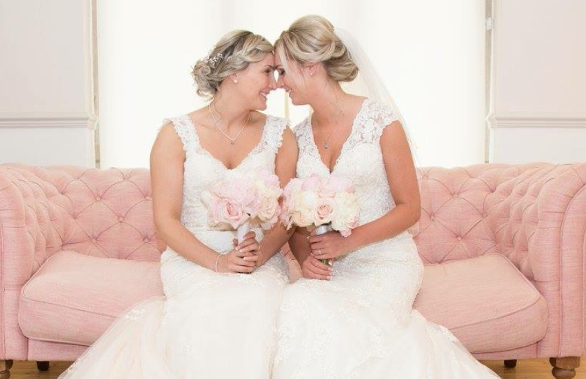 Kelly and Laura Sibley kissing on their wedding day