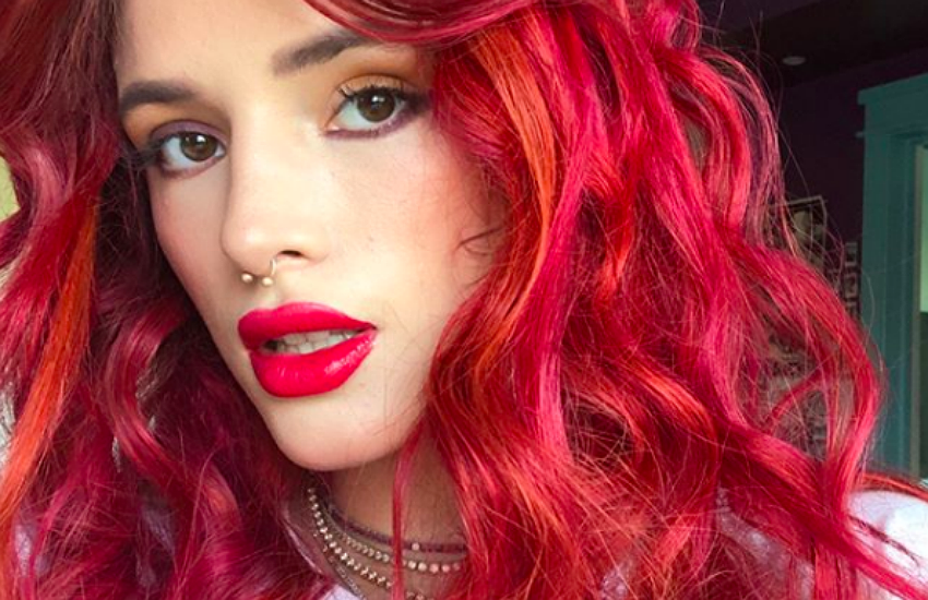 Bella Thorne with freshly dyed bright red hair