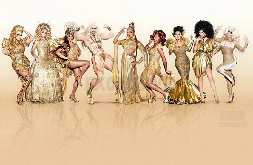 The cast of RuPaul's Drag Race All Stars 3 standing in a row all wearing gold clothes