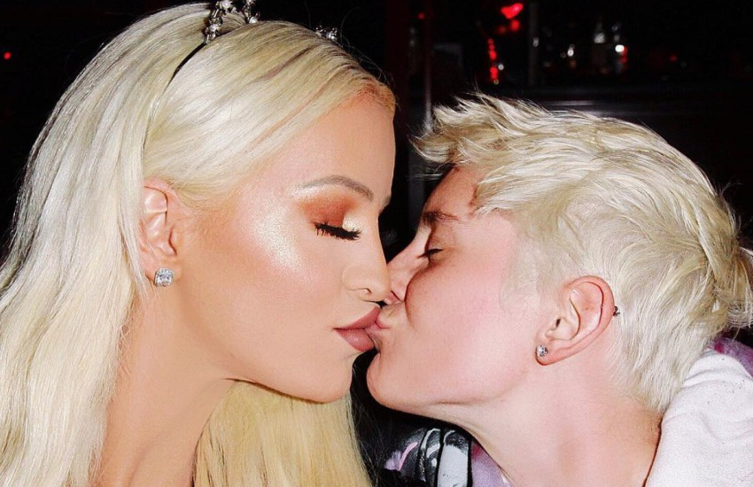 Gigi Gorgeous and Nats Getty kissing on the lips