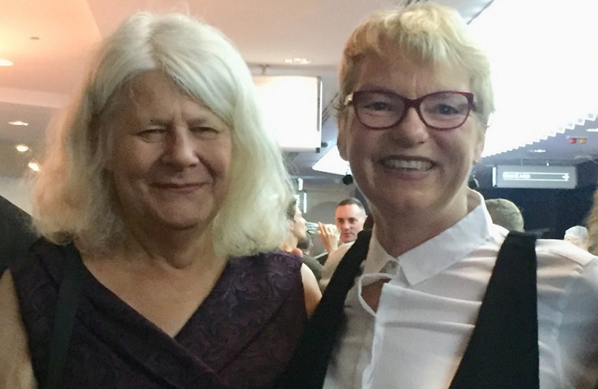 Penny Whetton with her wife Australian Greens Senator Janet Rice smiling and standing