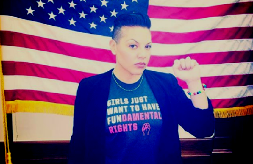 Sara Ramirez in a shirt that reads 'Girls Just Want To Have FUN-damental rights!'