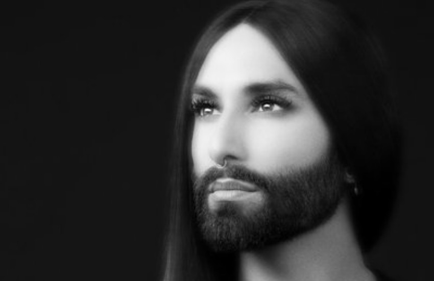 A soft focus black and white shot of conchita wurst she's is looking up at an angle away from the camera