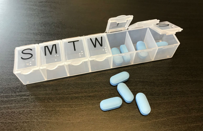 A pill dispenser with PrEP / Truvada tablets to prevent HIV infection