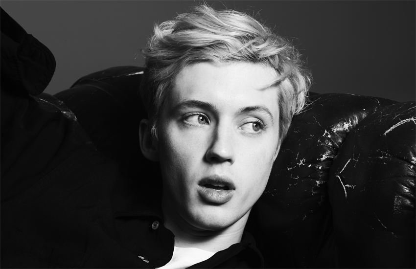 A black and white photo of Troye Sivan