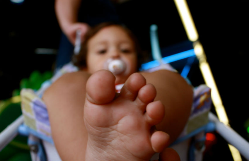 Child toes with a dummy