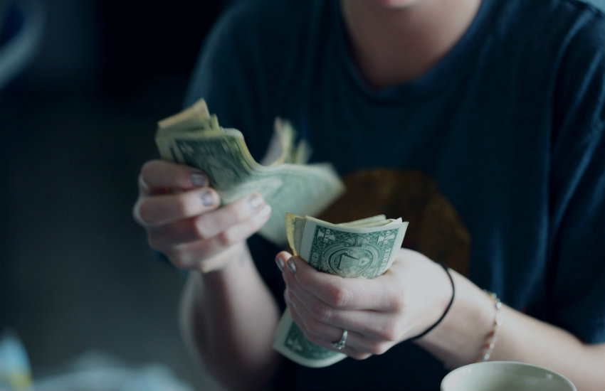 A woman counting money