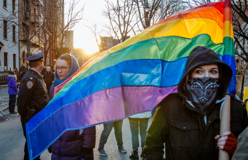 A protestor at an LGBTI solidarity event in front of Stonewall