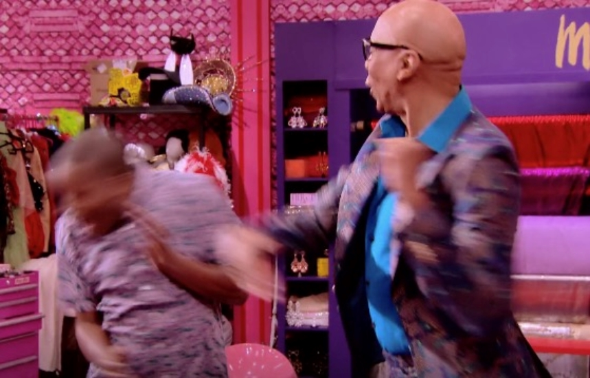 Two people face each other, RuPauls is slapping the other person who is flinching backwards
