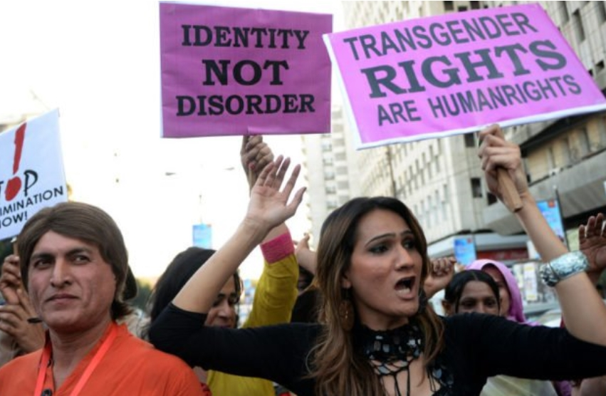 A group of trans women protest on the streets and holding signs saying transgender rights are human rights