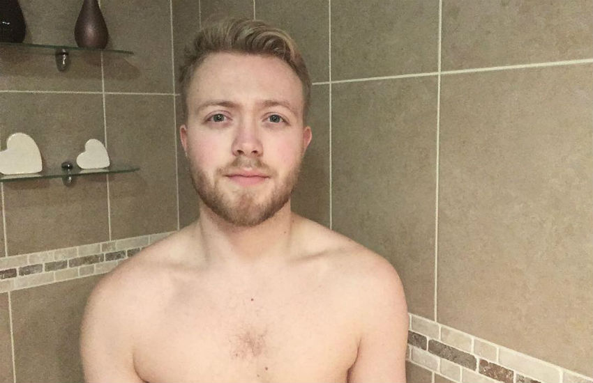Chris Whiting shirtless and standing in a shower