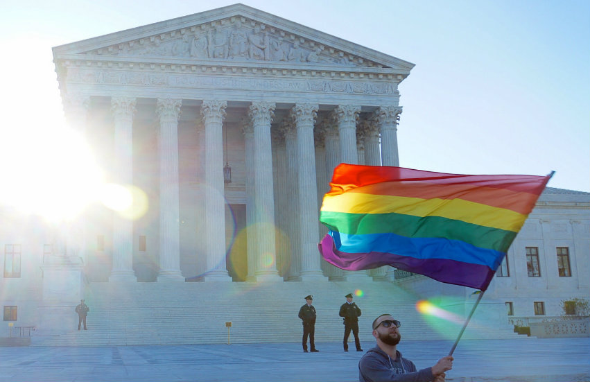 Waving a rainbow flag in front of the Supreme Court building