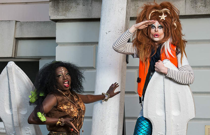 Two drag performers in mermaid costumes at the National Maritime Museum.