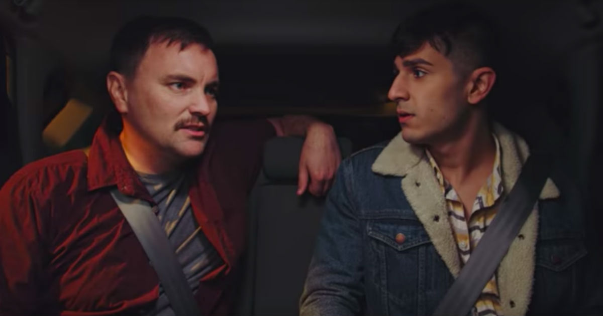 Two men in a taxi discuss HIV in the video from New Zealand