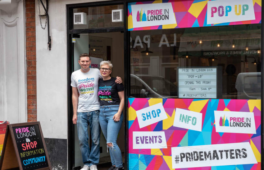 Kieron Yates and Sheena Carmichael at the entrance of the new Pride in London's pop-up shop in Soho.