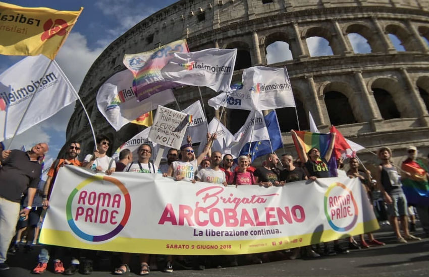 The 'Rainbow Brigade' banner leads the Rome Pride march