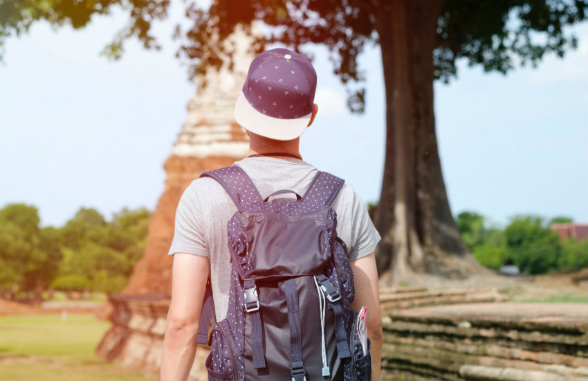 A man on vacation with a backpack on his back - did he take travel insurance out?