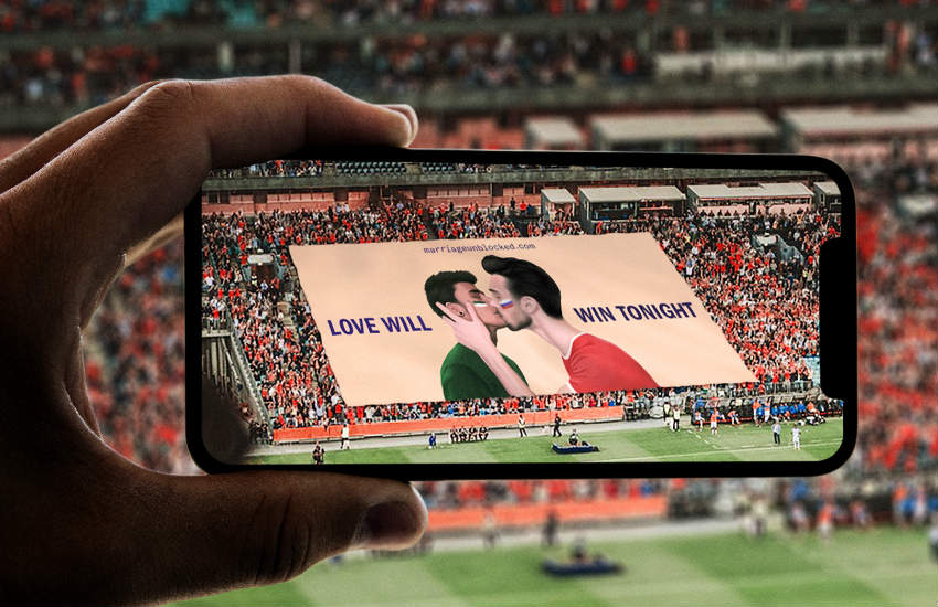 The AR displaying a gay couple kissing with Saudi Arabia and Russia flags on their cheeks.